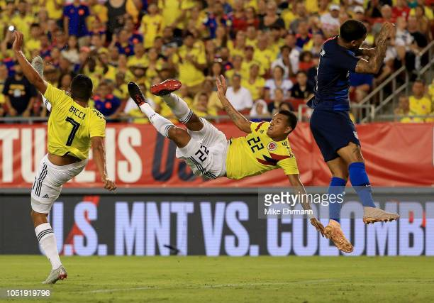 Jeison Murillo of Colombia takes a shot on DeAndre Yedlin of Unites States during an International Friendly at Raymond James Stadium on October 11,...