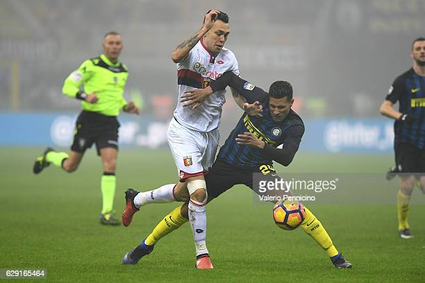 Jeison Murillo of FC Internazionale clashes with Lucas Ocampos of Genoa CFC during the Serie A match between FC Internazionale and Genoa CFC at...