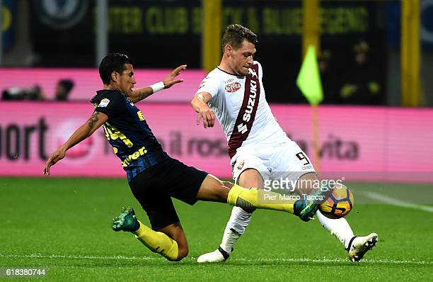 Jeison Murillo of FC Internazionale comptes for the ball with Andrea Belotti of FC Torino during the Serie A match between FC Internazionale and FC...