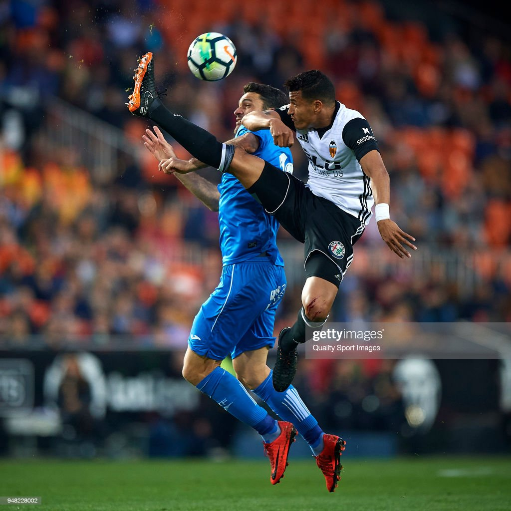 Jeison Murillo (R) of Valencia competes for the ball with Jorge Molina of Getafe during the La Liga match between Valencia and Getafe at Mestalla Stadium on April 18, 2018 in Valencia, Spain.