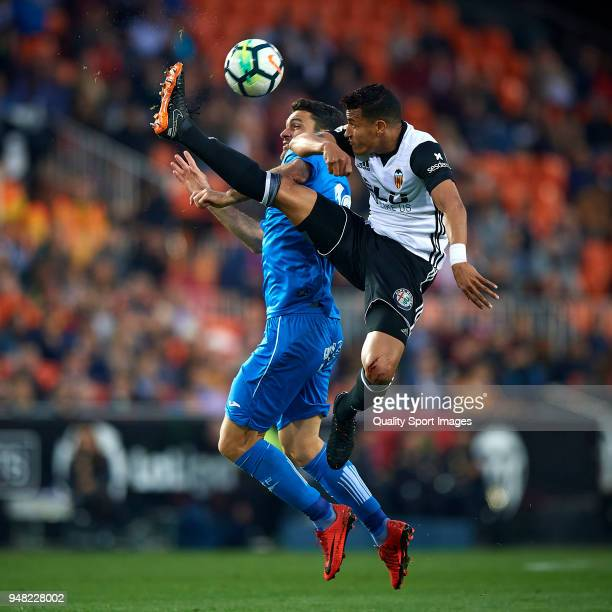 Jeison Murillo of Valencia competes for the ball with Jorge Molina of Getafe during the La Liga match between Valencia and Getafe at Mestalla Stadium...