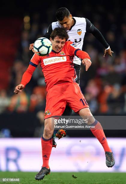Jeison Murillo of Valencia competes for the ball with Mikel Oyarzabal of Real Sociedad during the La Liga match between Valencia CF and Real Sociedad...