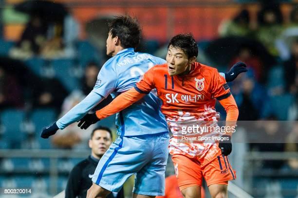 Jeju United FC Forward Hwang Ilsu in action against Jiangsu FC Defender Hong Jeongho during the AFC Champions League 2017 Group H match between Jeju...