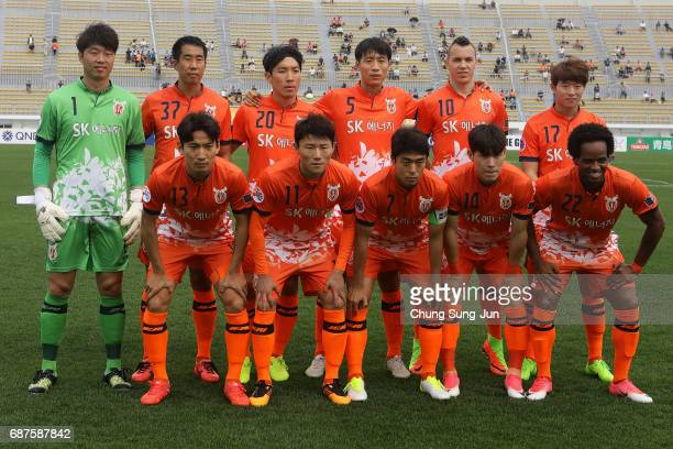Jeju United FC team pose during the AFC Champions League Round of 16 match between Jeju United FC and Urawa Red Diamonds at Jeju World Cup Stadium on...