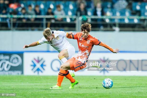 Jeju United Forward Ahn Hyunbeom fights for the ball with Adelaide United Midfielder Riley Patrick Mcgree during the AFC Champions League 2017 Group...