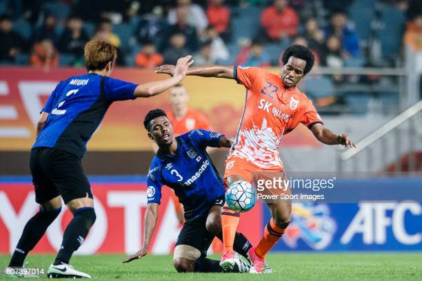 Jeju United Forward Magno Da Cruz fights for the ball with Gamba Osaka Defender Fabio Da Silva during the AFC Champions League 2017 Group H match...