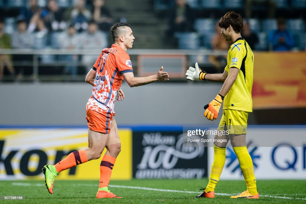 Jeju United Forward Marcelo Toscano high five with Gamba
