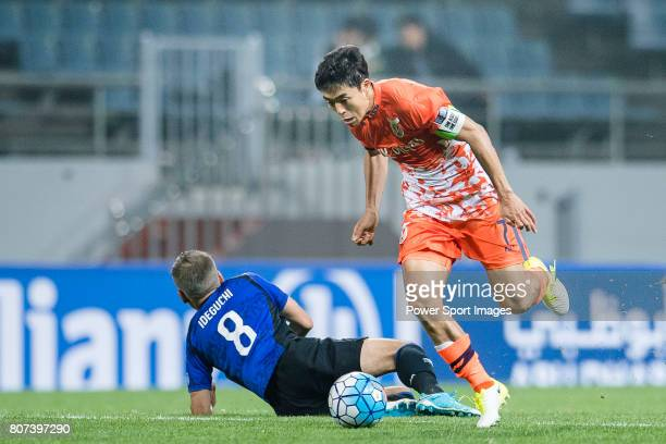 Jeju United Midfielder Kwon Soonhyung trips up with Gamba Osaka Midfielder Ideguchi Yosuke during the AFC Champions League 2017 Group H match Between...