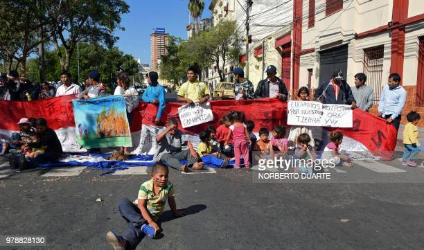 Jejytymiri indigenous people demonstrate in demand of their territorial rights in front of the congress in Asuncion, on June 19, 2018.