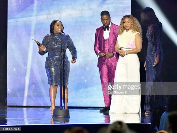Jekalyn Carr accepts the Female Vocalist of the Year award from Donald Lawrence and Erica Campbell during the 34th annual Stellar Gospel Music Awards...