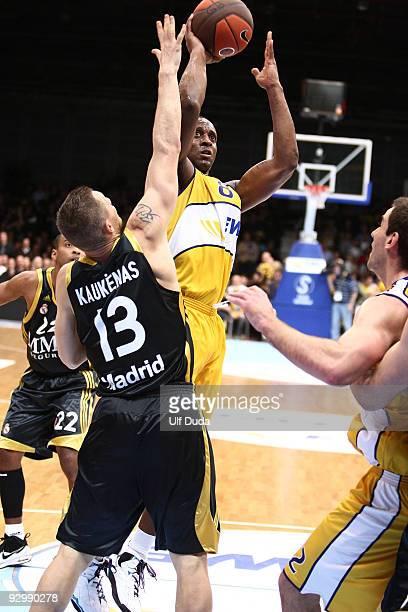 Jekel Foster, #8 of EWE Basket Oldenburg competes with Rimantas Kaukenas, #13 of Real Madrid during the Euroleague Basketball Regular Season...