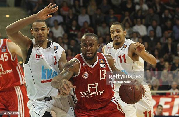 Je'Kel Foster of Bayern Muenchen fights for the ball with Alex King and John Little of s.Oliver Baskets Wuerzburg during the basketball Bundesliga...