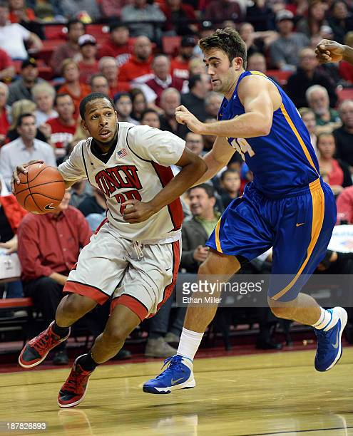 Jelan Kendrick of the UNLV Rebels drives against Shawn Moore of the UC Santa Barbara Gauchos during their game at the Thomas Mack Center on November...