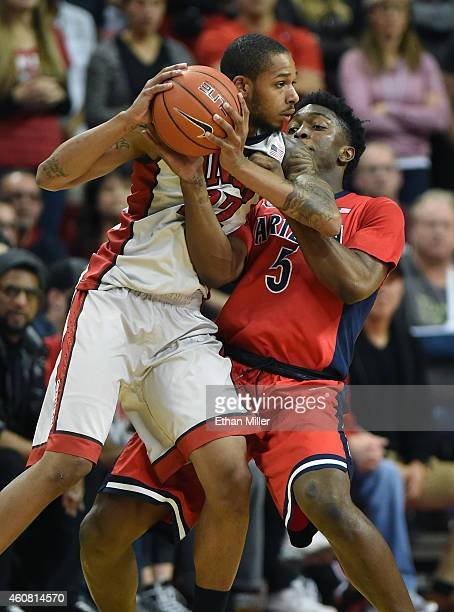 Jelan Kendrick of the UNLV Rebels leans into Stanley Johnson of the Arizona Wildcats during their game at the Thomas Mack Center on December 23 2014...