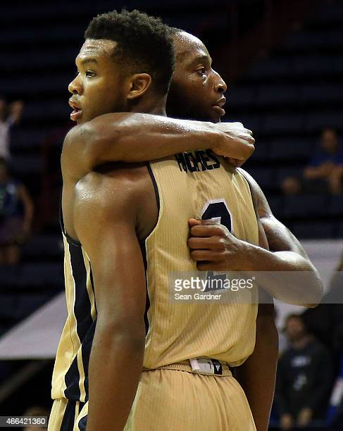 Jelani Hewitt of the Georgia Southern Eagles reacts with Mike Hughes of the Georgia Southern Eagles after a play against the Georgia State Panthers...