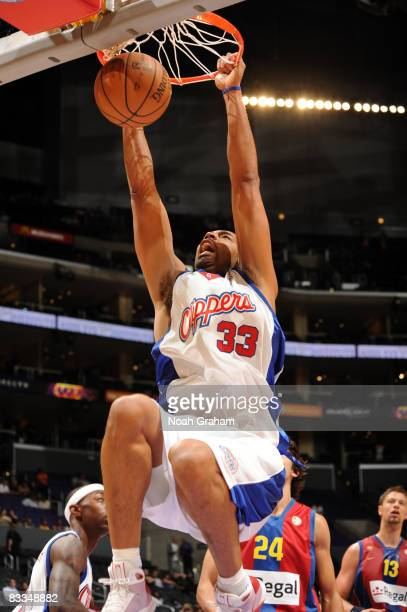 Jelani McCoy of the Los Angeles Clippers dunks during the game against Regal FC Barcelona at Staples Center on October 19 2008 in Los Angeles...