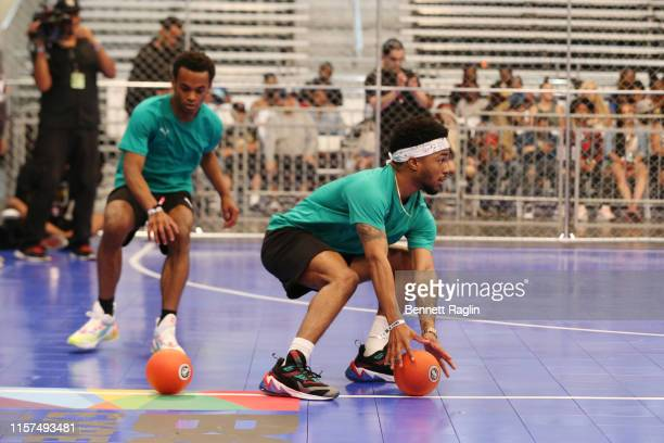 Jelani Winston and Christopher Jefferson play in the 2019 BET Experience Celebrity Dodgeball Game at Staples Center on June 21 2019 in Los Angeles...