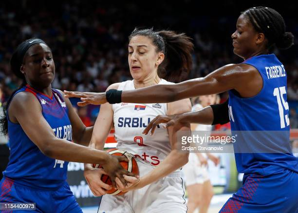 Jelena Brooks of Serbia is challenged by Janice Monakana and Temi Fagbenle of Great Britain during the FIBA Women's Eurobasket 2019 bronze medal...
