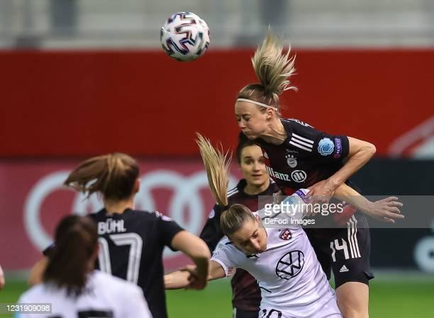 Jelena Cankovic and Amanda Ilestedt battle for the ball during the First Leg of the UEFA Women's Champions League Quarter Final match between Bayern...
