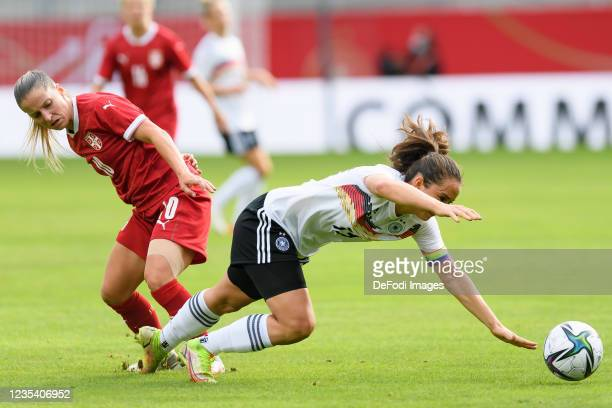Jelena Cankovic of Serbia and Sara Draebitz of Germany battle for the ball during the FIFA Women's World Cup 2023 Qualifier group H match between...