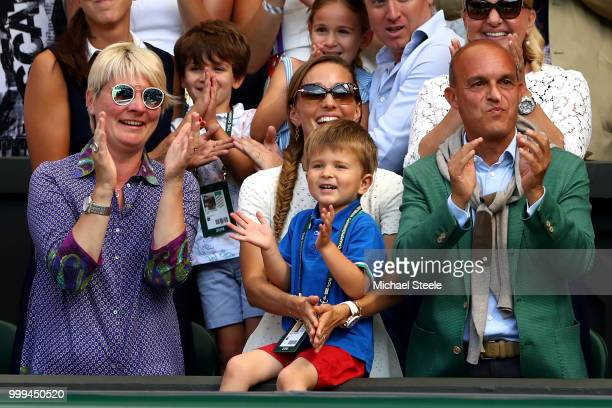 Jelena Djokovic , wife of Novak Djokovic of Serbia, and their son Stefan Djokovic applaud after the Men's Singles final on day thirteen of the...