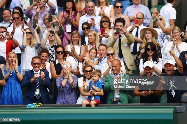 Jelena Djokovic wife of Novak Djokovic of Serbia and their son Stefan Djokovic applaud after the Men's Singles final on day thirteen of the Wimbledon...