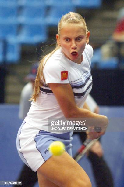 Jelena Dokic from Australia hits a backhand to French Sandrine Testud during the Federation Cup first round match in Moscow 28 April 2000 Dokic won...