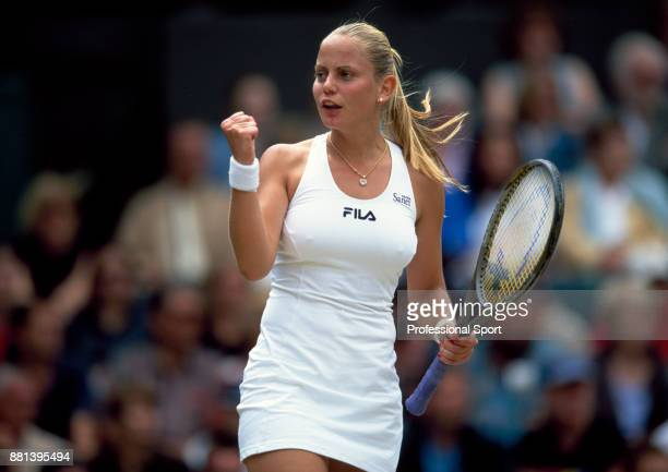 Jelena Dokic of Australia celebrates during the Wimbledon Lawn Tennis Championships at the All England Lawn Tennis and Croquet Club, circa June, 2002...