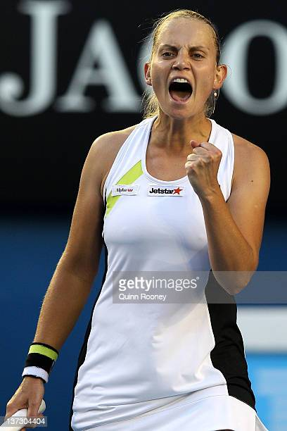 Jelena Dokic of Australia celebrates winning a point in her second round match against Marion Bartoli of France during day four of the 2012...