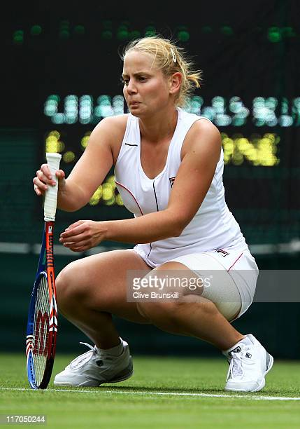Jelena Dokic of Australia in action during her first round match against Francesca Schiavone of Italy on Day One of the Wimbledon Lawn Tennis...