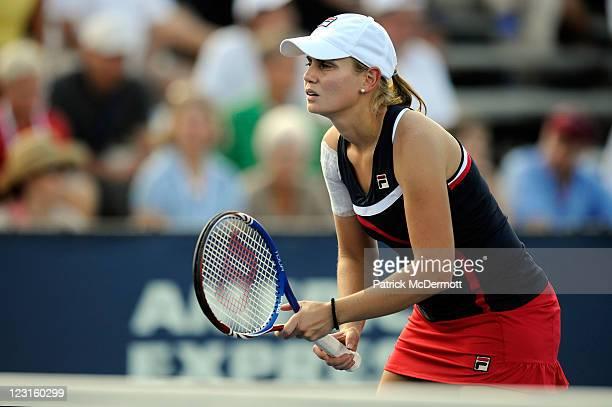 Jelena Dokic of Australia looks on during her doubles match with Virginie Razzano of France against Jarmila Gajdosova of Australia and Bethanie...
