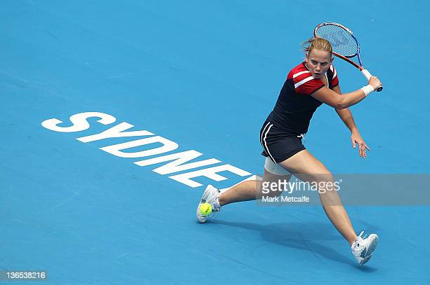 Jelena Dokic of Australia plays a backhand in her first round match against Isabella Holland of Australia during day one of the 2012 Sydney...