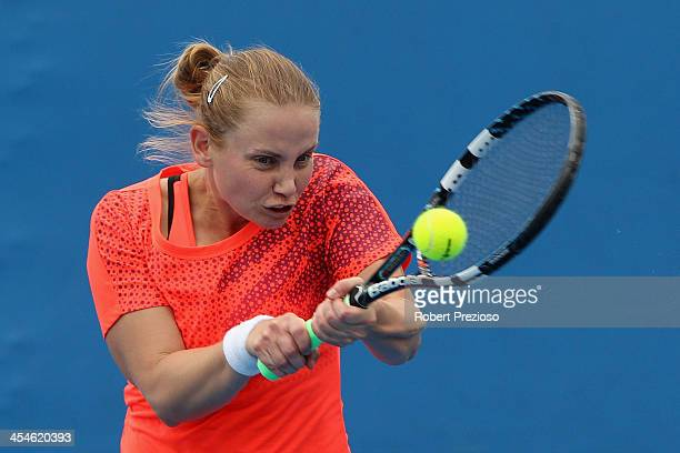 Jelena Dokic of Australia plays a backhand in her first round match against Jarmila Gajdosova of Australia in the Australian Open 2014 Qualifying at...