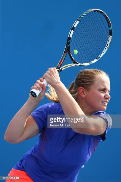 Jelena Dokic of Australia plays a backhand in her first round women's doubles match with Storm Sanders of Australia against Magdalena Rybarikova of...