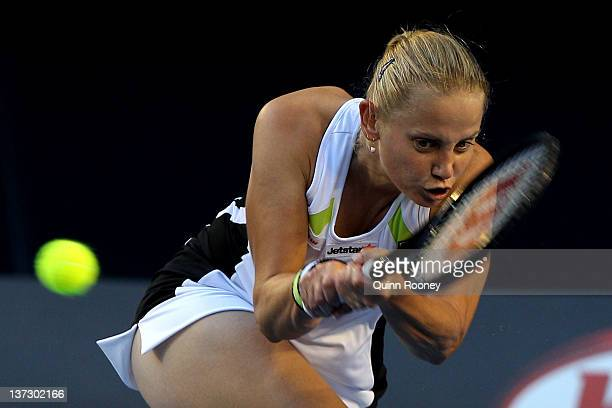 Jelena Dokic of Australia plays a backhand in her second round match against Marion Bartoli of France during day four of the 2012 Australian Open at...