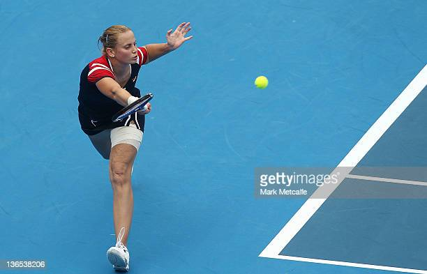 Jelena Dokic of Australia plays a forehand in her first round match against Isabella Holland of Australia during day one of the 2012 Sydney...