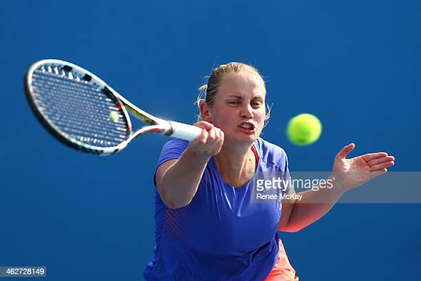 Jelena Dokic of Australia plays a forehand in her first round women's doubles match with Storm Sanders of Australia against Magdalena Rybarikova of...