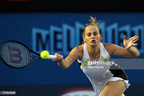 Jelena Dokic of Australia plays a forehand in her second round match against Marion Bartoli of France during day four of the 2012 Australian Open at...