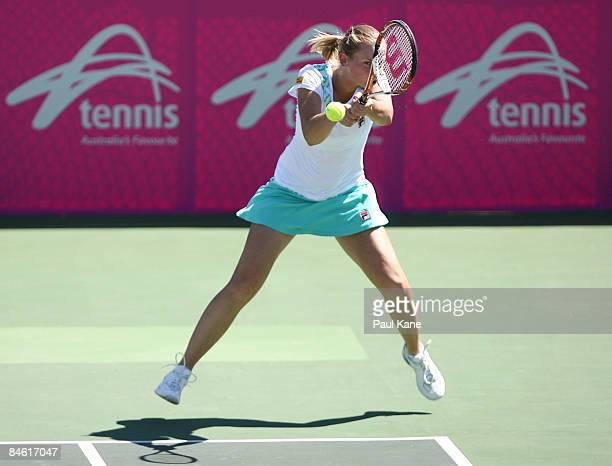 Jelena Dokic of Australia plays a return shot to Lee JinA of Korea during the first round Fed Cup match between Australia and Korea at The State...