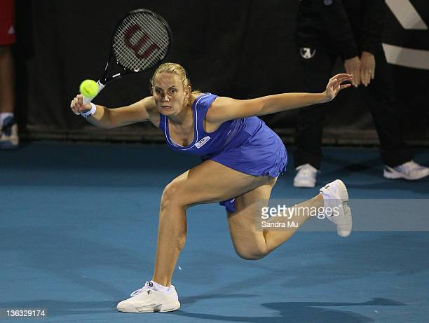 Jelena Dokic of Australia plays a shot in her match against Mona Barthel of Germany during day one of the 2012 ASB Classic at ASB Tennis Centre on...