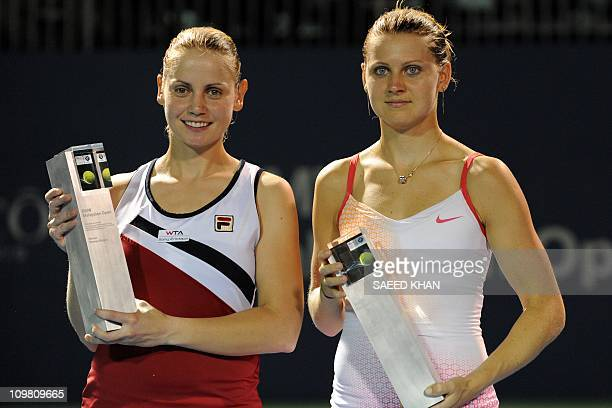 Jelena Dokic of Australia poses with Lucie Safarova of the Czech Republic after the final of the WTA Malaysian Open tennis tournament in Kuala Lumpur...