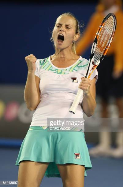 Jelena Dokic of Australia reacts, on her way to defeating Alisa Kleybanova of Russia in their women's tennis match on the seventh day of the...