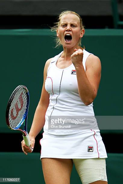 Jelena Dokic of Australia reacts to a play during her first round match against Francesca Schiavone of Italy on Day One of the Wimbledon Lawn Tennis...