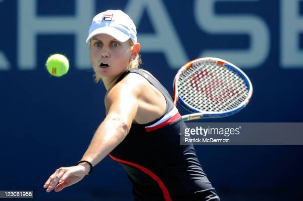 Jelena Dokic of Australia returns a shot against Olga Govortsova of Belarus during Day Two of the 2011 US Open at the USTA Billie Jean King National...
