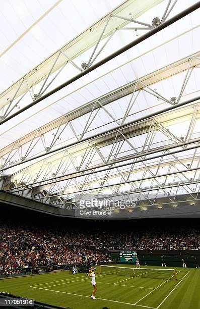Jelena Dokic of Australia serves after they closed the roof during her first round match against Francesca Schiavone of Italy on Day One of the...