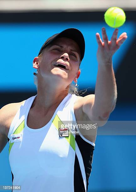 Jelena Dokic of Australia serves in her first round match against Anna Chakvetadze of Russia during day two of the 2012 Australian Open at Melbourne...