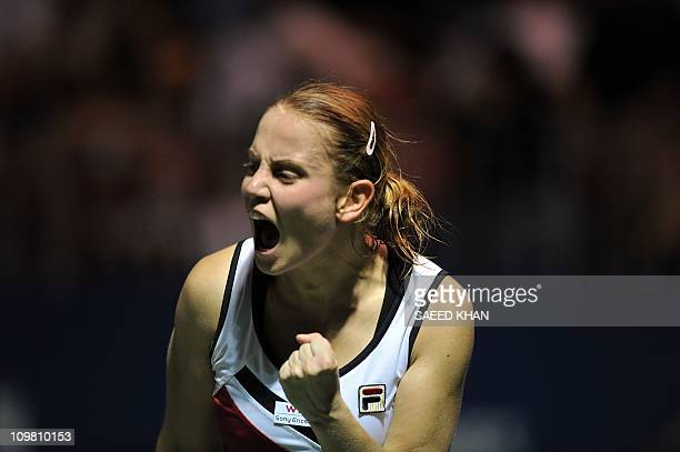 Jelena Dokic of Australia shouts in joy after securing a vital point against Lucie Safarova of the Czech Republic during the final of the WTA...