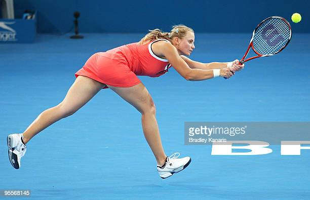 Jelena Dokic of Australia stretches out to play a backhand in her first round match against Ana Ivanovic of Serbia during day two of the Brisbane...