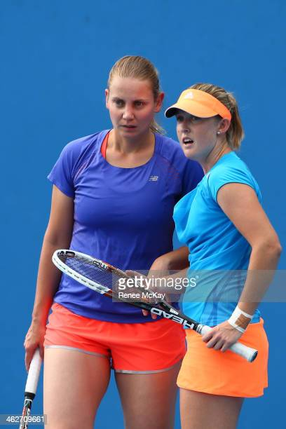 Jelena Dokic of Australia talks tactics with Storm Sanders of Australia in their first round women's doubles match against Magdalena Rybarikova of...