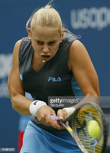 Jelena Dokic of Yugoslavia returns a backhand volley to Elena Bovina of Russia at the US Open Tennis Tournament 28 August 2002 in Flushing Meadows NY...
